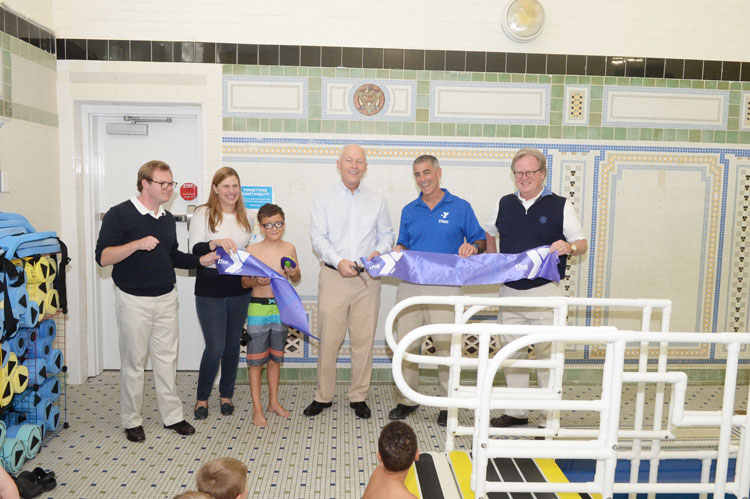 To commemorate the start of the program, YMCA CEO Bob DeAngelo, Abilis Community Foundation President Hal Ritch and Abilis CEO Dennis Perrypresided over a brief ribbon cutting ceremony welcoming the participants and their families.