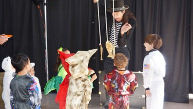 A magician entertains children at the Christ Church Nursery School Harvest Fair.