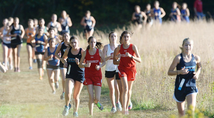 Members of the Greenwich High School girls' cross-country team compete at the FCIAC finals two weeks ago in New Canaan.  (John Ferris Robben photo)
