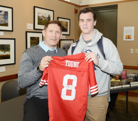 In addition to signing books, Steve Young signed a plethora of other object. Adam Chilvers, a fan of Young, traveled from Cranston, R.I. to get his San Francisco jersey signed by the Hall of Fame quarterback. (John Ferris Robben photo)