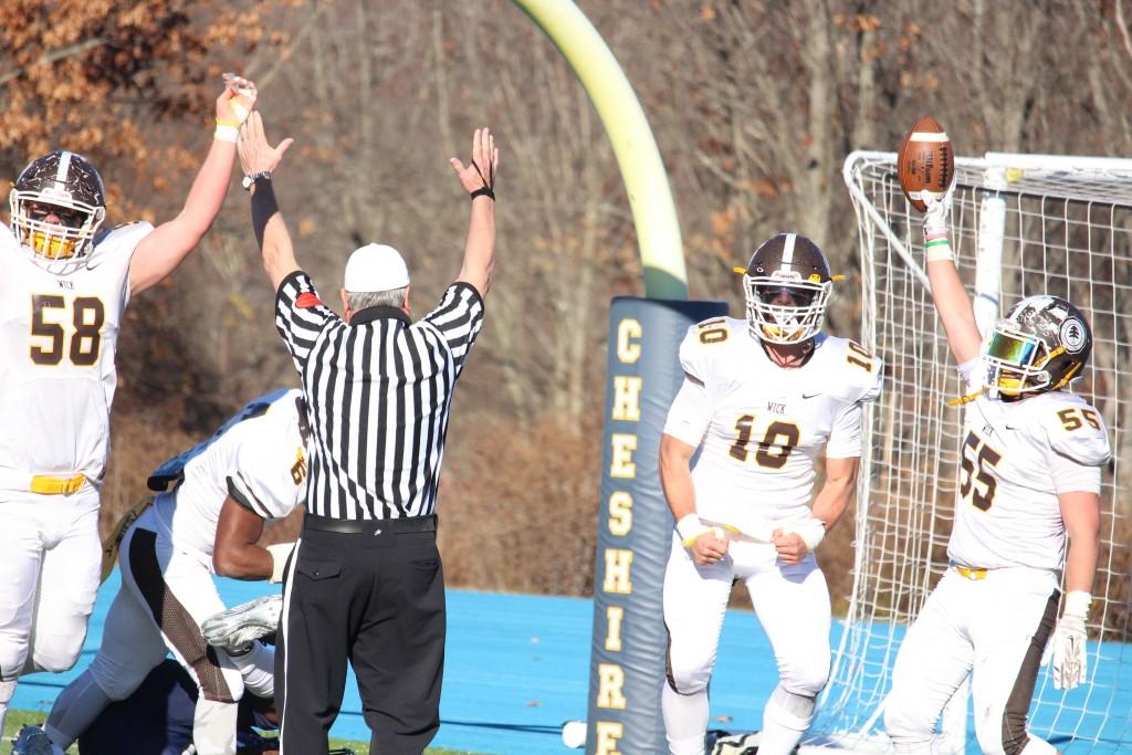 Brunswick's defense celebrates after scoring a touchdown in Saturday's bowl game (Evan Triantafilidis photo)