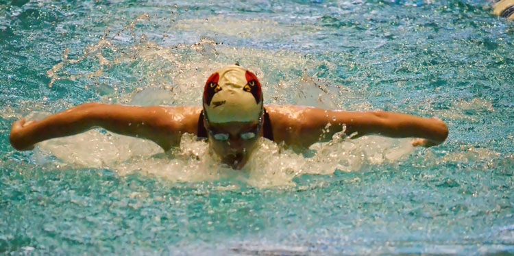 Greenwich High School's Kelly Montesi strikes gold in the 100-yard butterfly event during Saturday's CIAC state open finals at Yale University. (Paul Silverfarb photo)