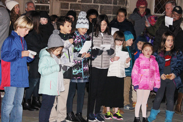 Kids from both Christ Church Greenwichand Temple Sholom came to sing holiday tunes before lighting the Christmas tree and menorah at the annual Interfaith celebration of lights. (contributed photo)