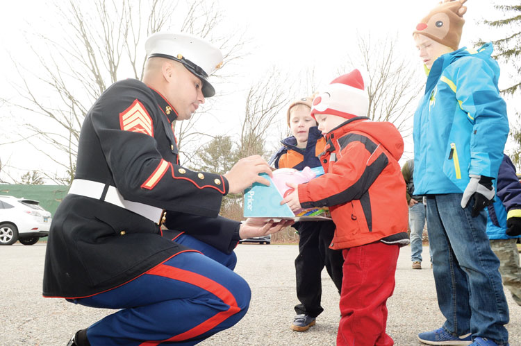 The U.S. Marines, along with Santa Claus, were at the Cos Cob Fire Station on Saturday for the annual Toys For Tots drive. The event started at 10 a.m., when Marines arrived in a seven-ton truck. In addition to Santa and the Marines, the Greenwich Fire Department, was there collecting toys, as was Greenwich Police. Even an antique fire engine was on the scene. (John Ferris Robben photo)