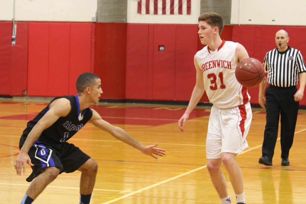 Greenwich's Conor Harkins hit the game-winning three-pointer as time expired Thursday night against Darien (Evan Triantafilidis photo)