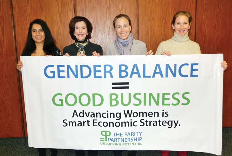 Parity Partnership members with a banner they'll carry at the march are, from left to right, Dr. Nim Patel, Dr. Deirdre Kamlani, Alex Bergstein and Mara Shore. (contributed photo)