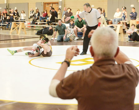 Brunswick School head coach Tim Ostrye looks on as one of his athletes takes to the mat during Saturday's BIT. (John Ferris Robben photo)