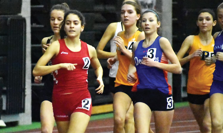 Greenwich High School junior Emily Philippides races to the front of the pack during last Thursday's FCIAC championship meet at the New Haven Athletic Center. (Paul Silverfarb photo)