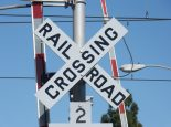 Railroad crossing gate lights train track railroads trains transportation freight