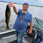 F5E7CACE-41F5-4D51-843E-4DB276417DBC: Our Dad and his big fish!