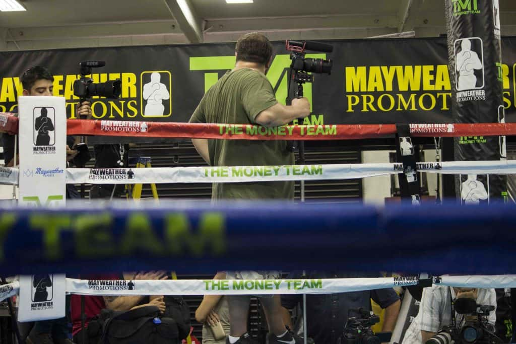 "72b62028ba72 Floyd ""Money"" Mayweather fields reporter questions at his gym in Vegas on  Aug. 10."