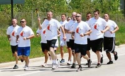 Runners in the 2015 Putnam County Law Enforcement Torch Run for Special Olympics