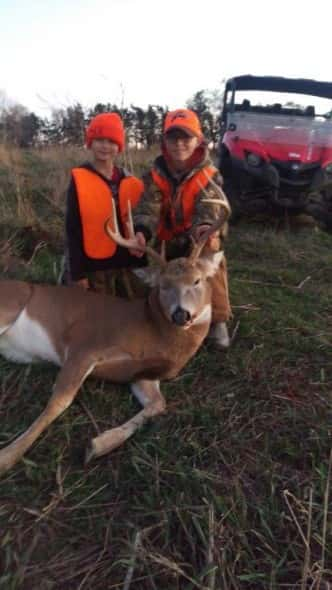 Chase Pritchett with his 4x4 buck and legendary guide Willie Nelson