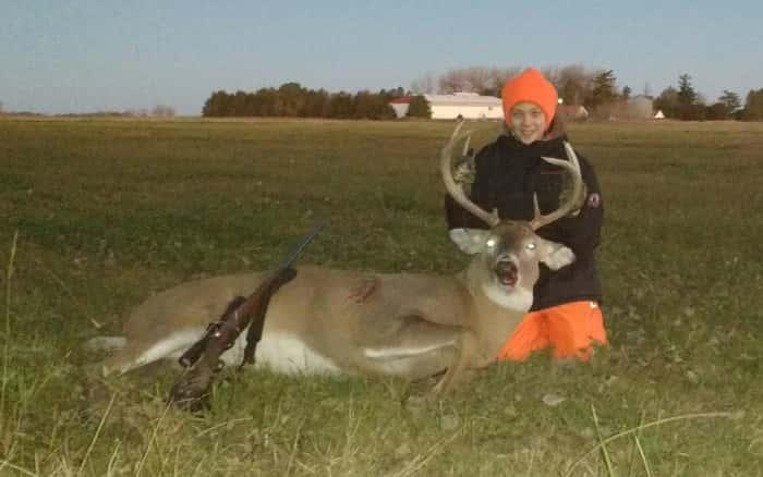 Dane Kilday with his dad's 4x4 Buck taken near Meadow Grove.