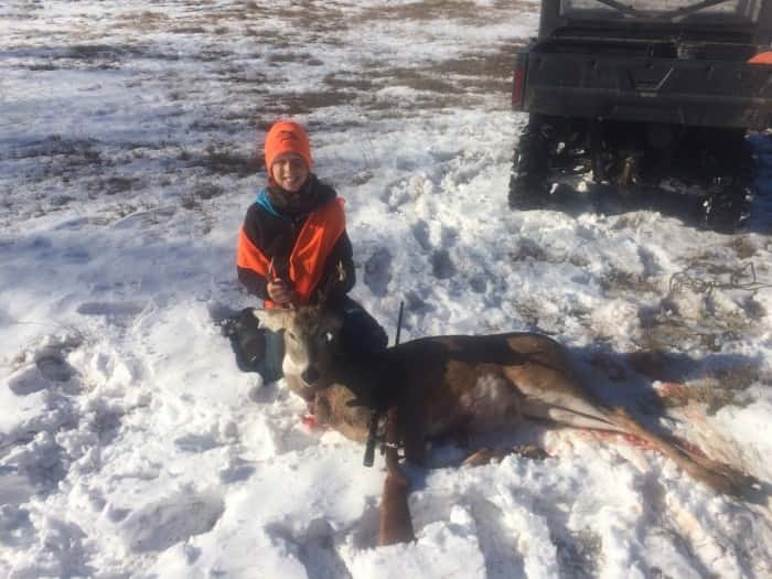 Haden Kaup with his first buck 3x2