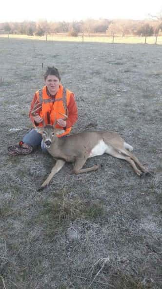 Hunter Alder with his buck.