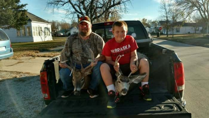 Shawn and Eli Owens Eli's 1st deer 2x2 muley 4x4 whitetail