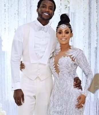 b6e73e42c25 Yesterday The Mane Event aired on BET and this wedding was all white and blinged  out like no other. Gucci Mane s long time girlfriend Keyshia was holding ...