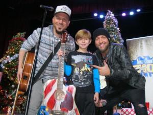 kid with locash guitar