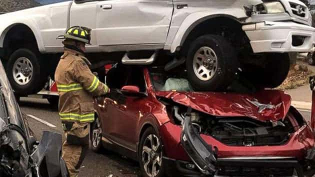 Four people walk away unscathed after three-vehicle crash in