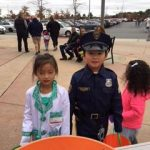 Off duty officer and doctor stop by for a candy break