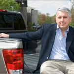 Car Doctor, John Paul sitting on back of truck