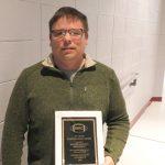 Ballard Memorial football coach Mark Brooks was given the J.O. Lewis Sportsmanship Award by the WKC football officials