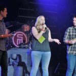 Dano, Amber and Tanner getting the crowd at Luther Burbank Center for the Arts excited for Scotty McCreery