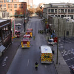 Emergency crews stage near the scene of an explosion in downtown Nashville, Tenn., Friday, Dec. 25, 2020. Buildings shook in the immediate area and beyond after a loud boom was heard early Christmas morning. (AP Photo/Mark Humphrey)