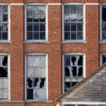 Windows are blown out in a building near the scene of an explosion in downtown Nashville, Tenn., Friday, Dec. 25, 2020. Buildings shook in the immediate area and beyond after a loud boom was heard early Christmas morning.(AP Photo/Mark Humphrey)