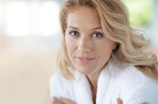 40 year old woman in bathrobe