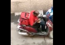 delivery guy eats food