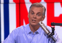 colin cowherd in front of nfl logo with mic