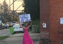 breaux bridge man stands in pink dress loses bet to wife