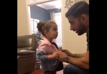 daughter takes jacket from pre school