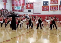 priest dances at cardinal gibbons pep rally