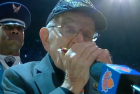 96 year old WWII vet plays harmonica at knicks game