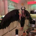 Maleficent: Handmade Maleficent costume. Each feather was cut from foam, striated with a box cutter, and hand painted by me. Each wing has an actuator so they open and close. 12 foot wingspan. Took me three months to create!