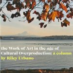 """Photo of lake with a mountain in the background and autumn leaves in the foreground. Over the photo some text reads """"the work of art in the age of cultural overproduction:a column by Riley Urbano"""""""