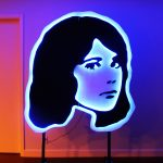 Neon outline of a woman's face on a red, blue, and purple background