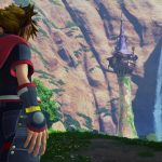 Avatar in Kingdom Hearts 3 looks out onto Rapunzel's tower in the middle of a valley