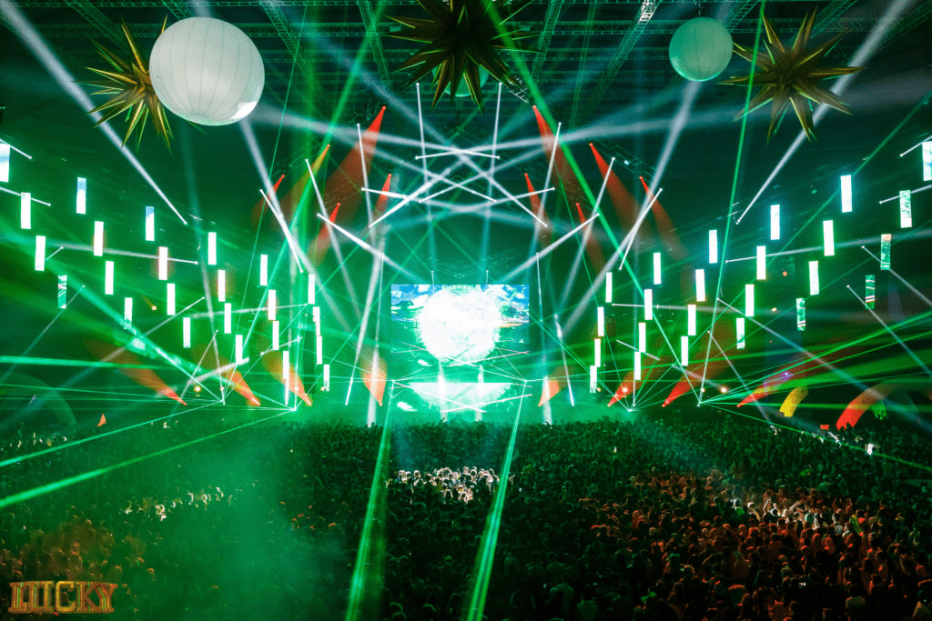 Green laser beams illuminate the large crowd of the Lucky Festival.