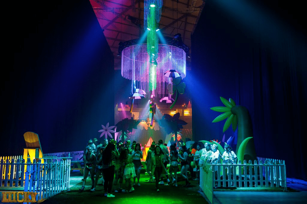 The venue for Lucky Festival is extravagantly decorated. Green and purple lights light up the room and clovers and sparkling decorations hang from the ceiling.