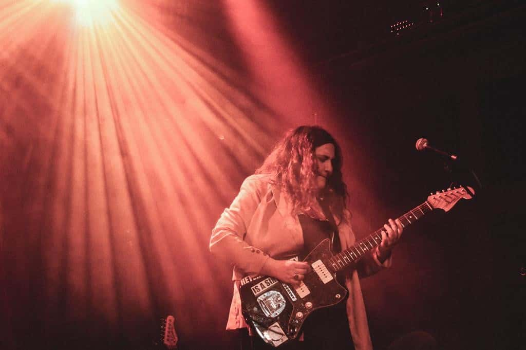 """Palehound's Ellen Kempner with her guitar which states """"heterosexuality is a sin"""""""