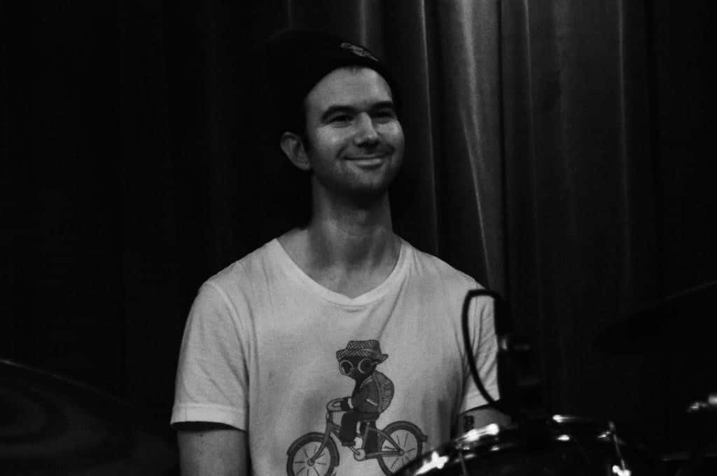 Drummer Jesse Weiss smiling at the audience during Palehound's set
