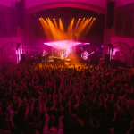 Walk the Moon performing at The Neptune with fuchsia lighting