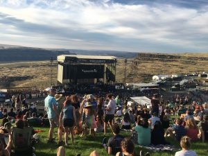 Audience watching Beck perform, surrounding the stage at the Gorge Ampitheatre.