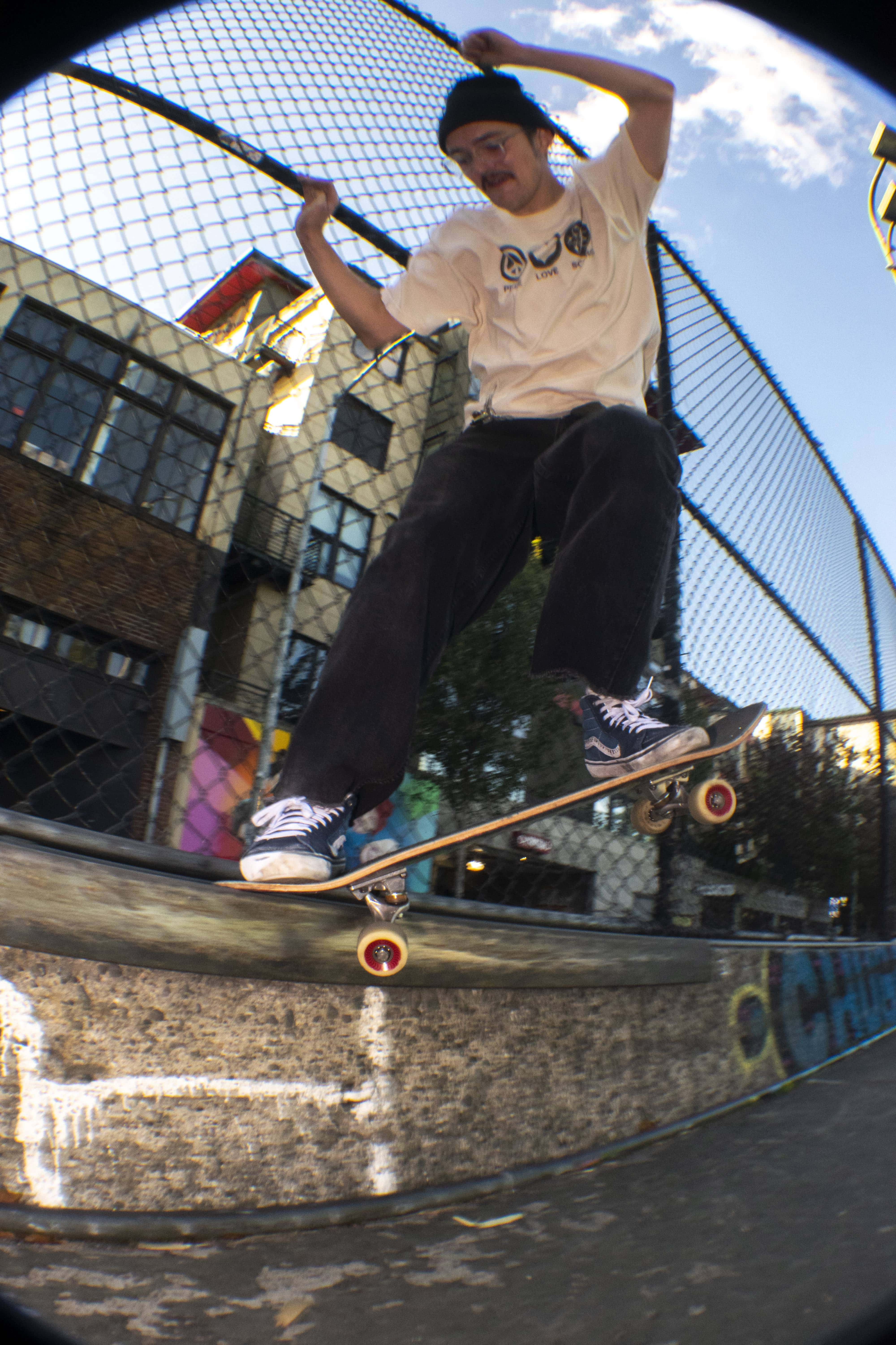 Image of a skateboard grinding against a curb.
