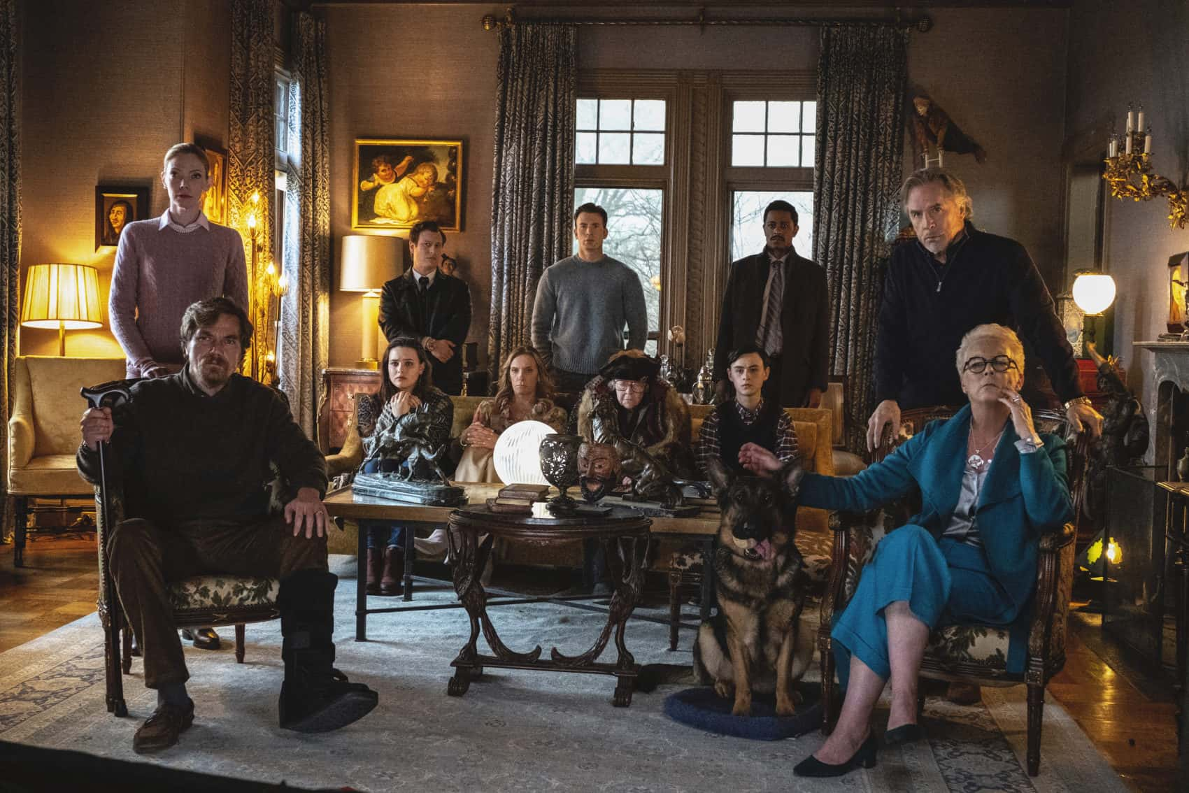 The star-studded Thrombey family awaits Detective Blanc's (Daniel Craig) conclusion in their grandfather's living room.