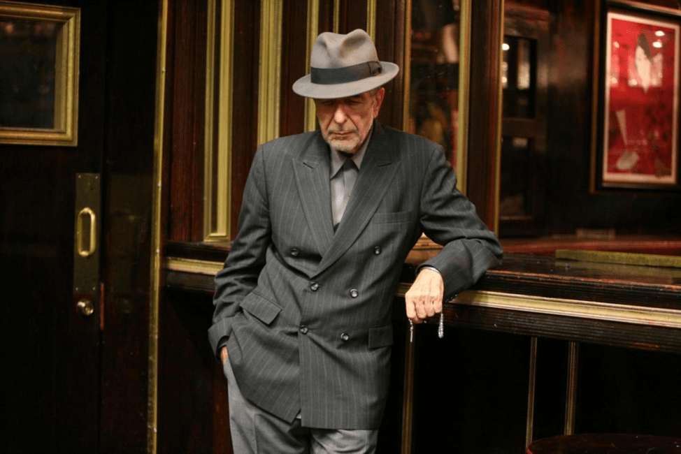 : Leonard Cohen posed in suit.